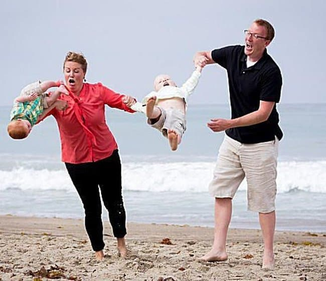 dropping-the-babies-on-the-beach-hilarious-family-photos