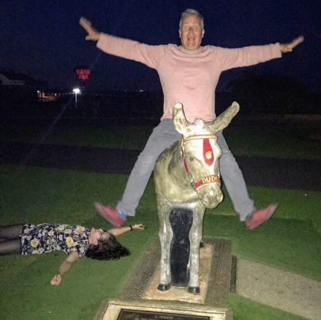 drunk-daughter-lying-on-the-ground-and-drunk-dad-riding-a-statue