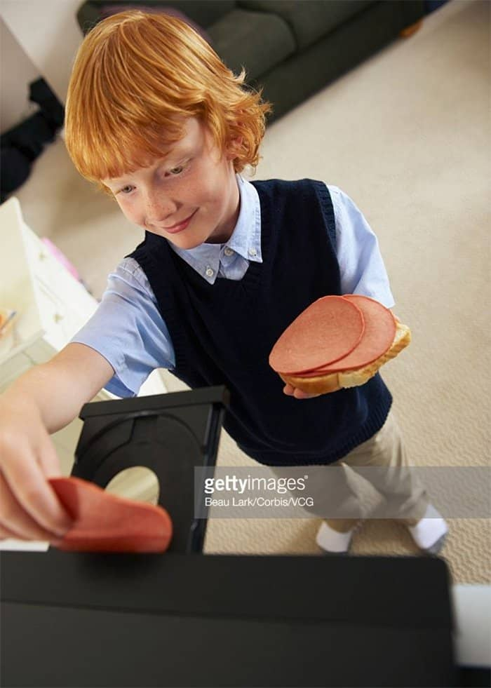 ham-inserted-into-disc-drive-weird-stock-photos