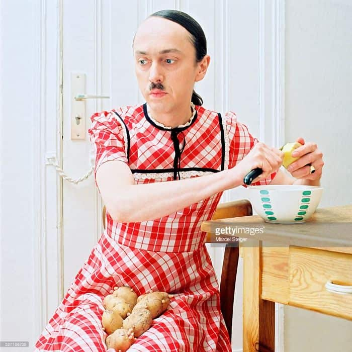 hitler-in-girl-outfit-peeling-potatoes-weird-stock-photos