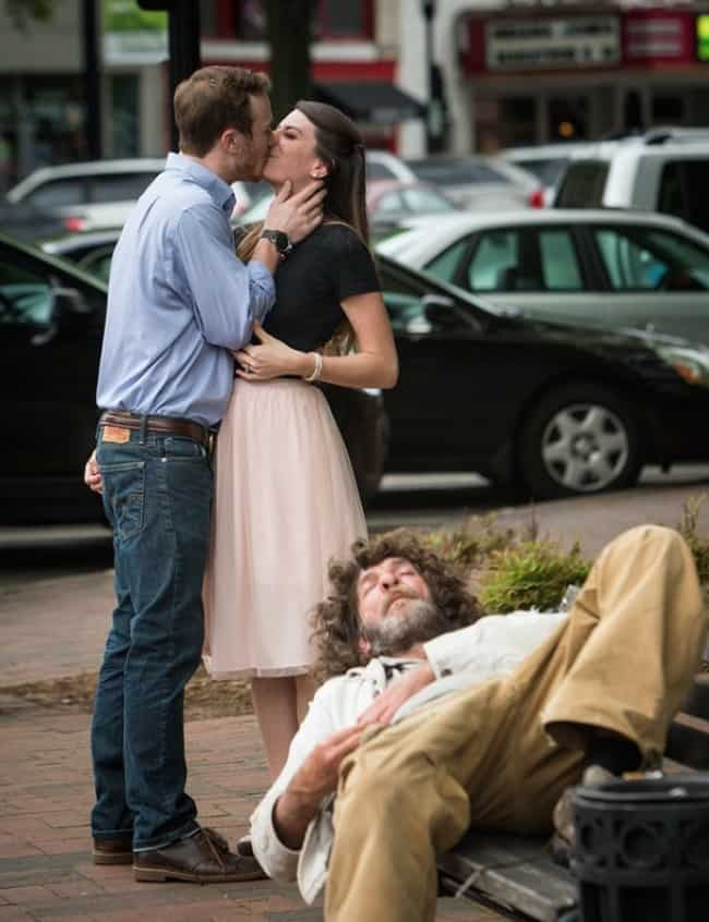 kissing-couple-with-a-homeless-man-sleeping-beside-them