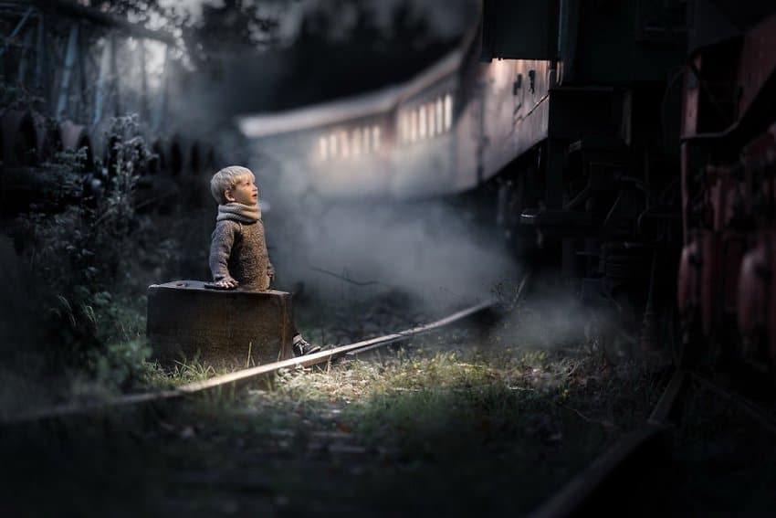 little-boy-beside-a-train-track-in-stadthagen-germany