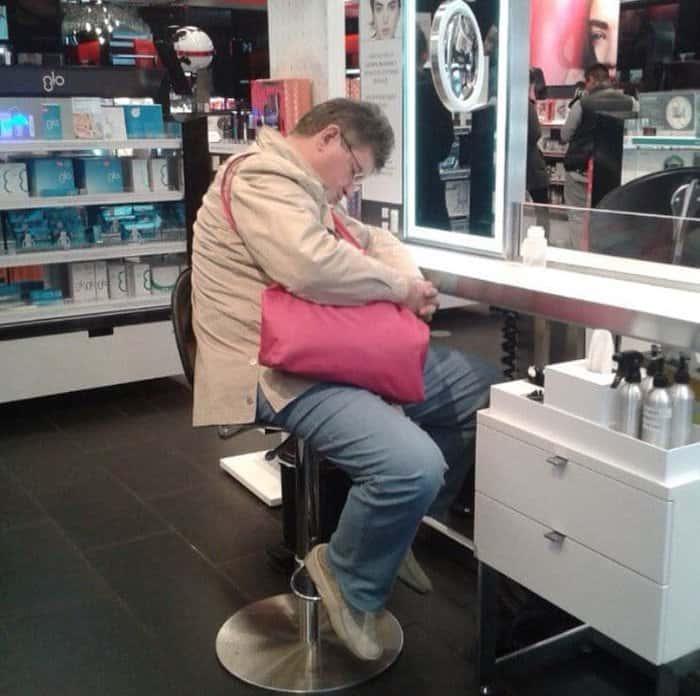 man-doozing-off-at-sephora-men-hate-shopping