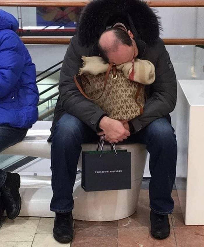 man-falling-asleep-while-waiting-for-girlfriend-men-hate-shopping