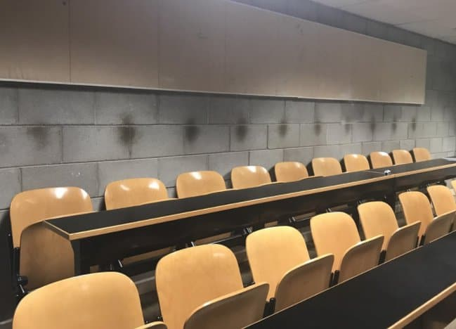 markings-people-head-on-a-lecture-wall-time-shows-no-mercy