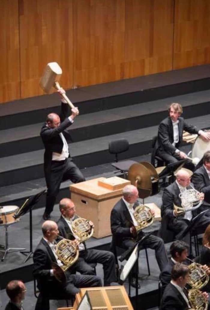 orchestra-man-with-a-wooden-hammer-confusing-photos