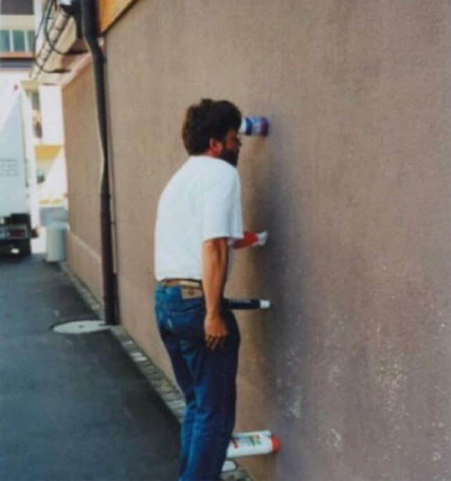 pressing-plastic-bottles-against-the-wall-hilariously-mysterious-photos