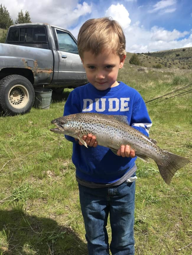 son-caught-fish-for-father-proud-parents