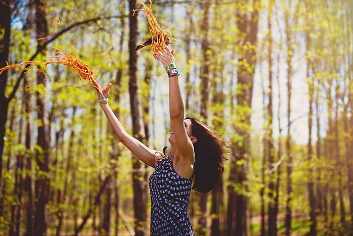 woman-throwing-spaghetti-in-the-forest-weird-stock-photos