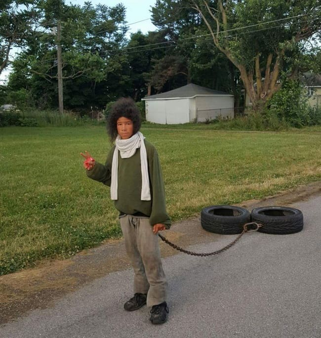 young-man-jogging-while-dragging-tires