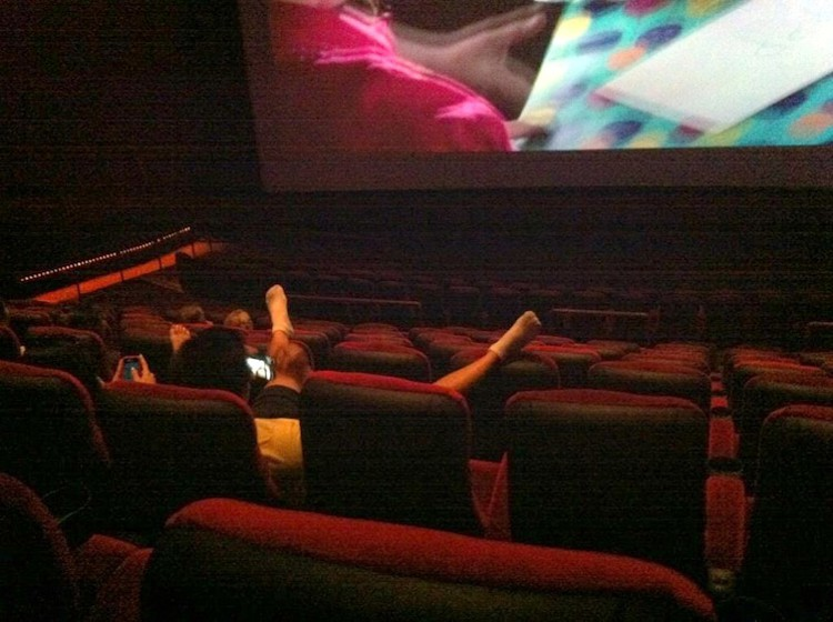 feet-raised-up-high-people-banned-from-movie-theaters