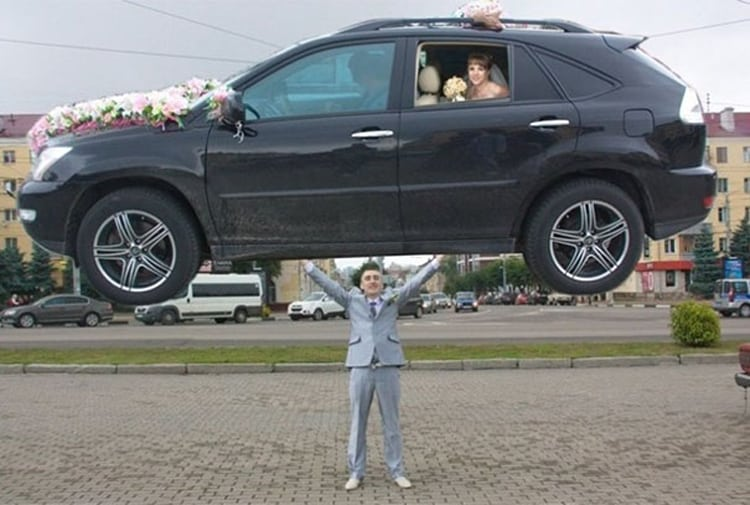 groom-lifting-bride-car-funny-russian-wedding-photos