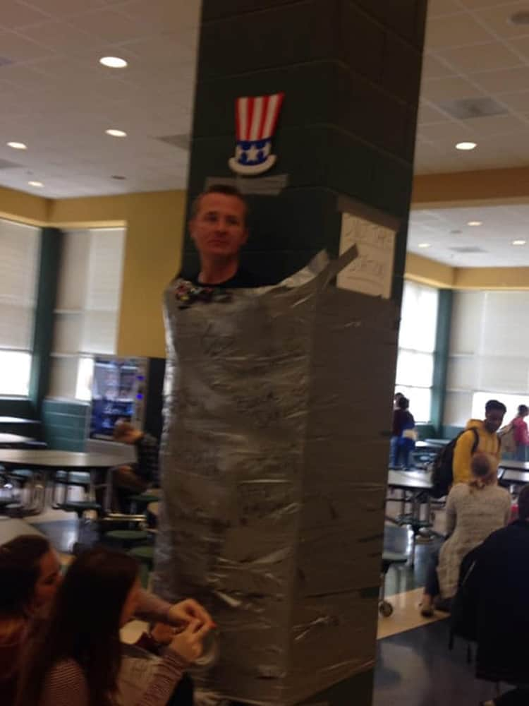 man-duct-taped-on-a-post-baffling-situations