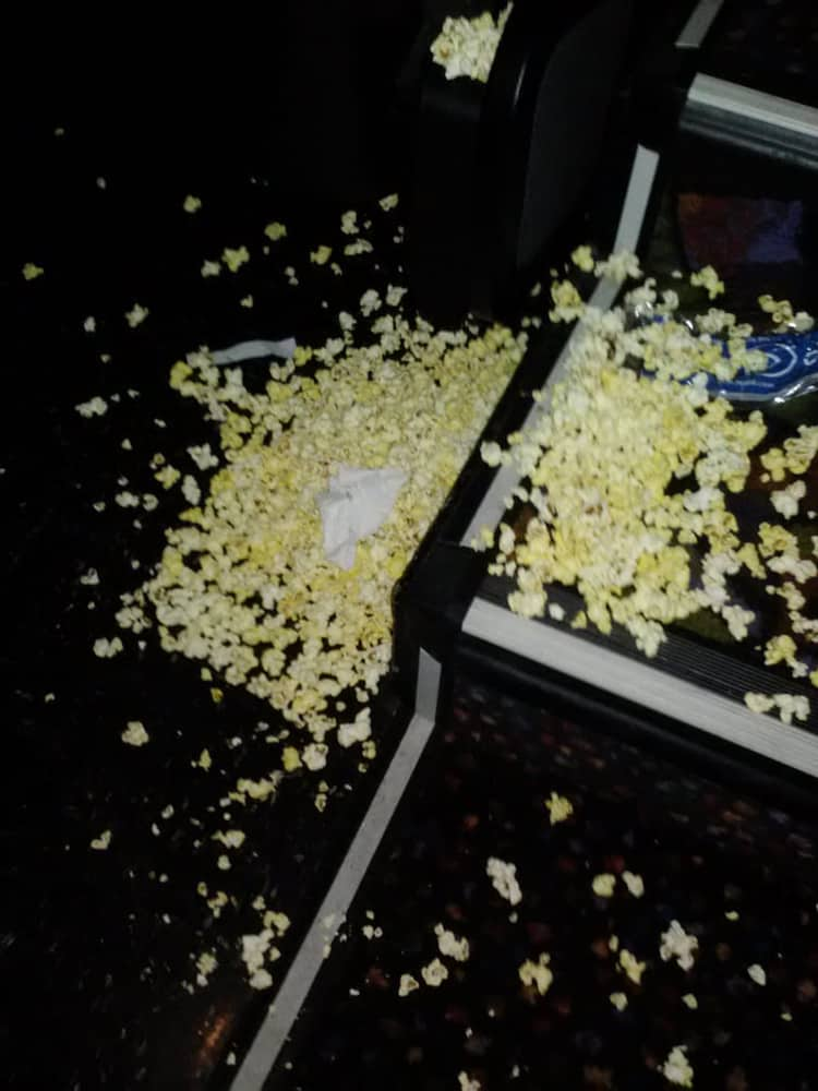 popcorn-scattered-all-over-the-floor-people-banned-from-movie-theaters