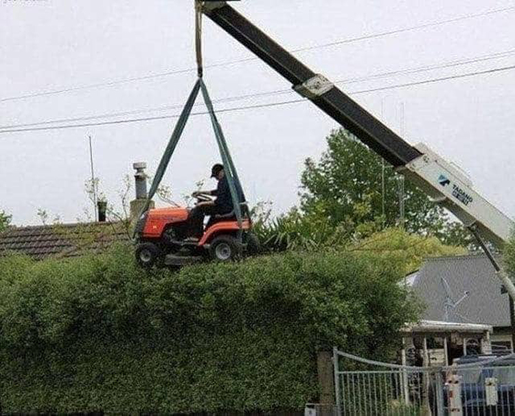 lawn-tractor-lifeted-by-crane-funny-proofs-earth-goofball
