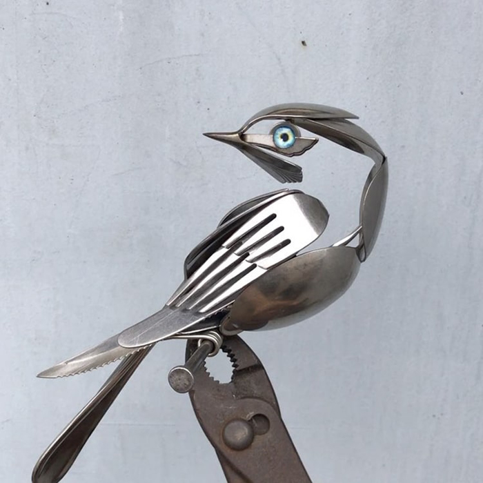 bird sculpture from forks and spoons