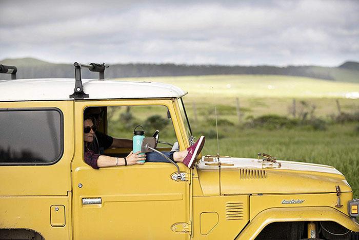 blue water bottle in yellow jeep