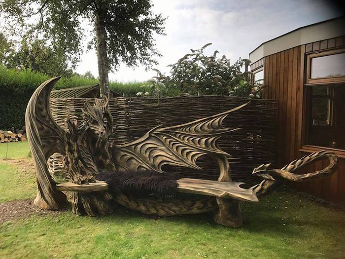 chainsaw sculpture dragon bench