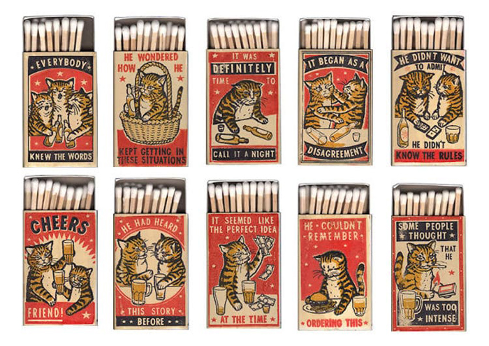 matchboxes featuring cat illustrations