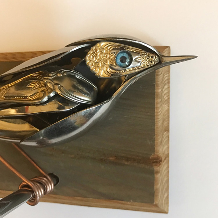 metal bird sculpture blue eyes