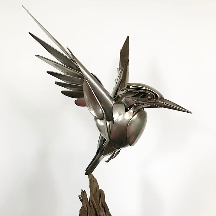 metal bird sculpture flying