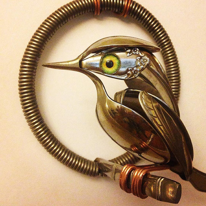 metal bird sculpture green eyes