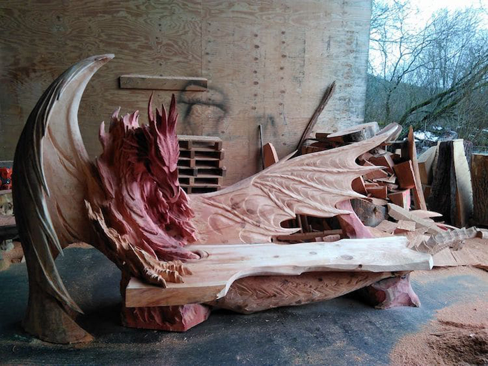 red tinged wood dragon bench