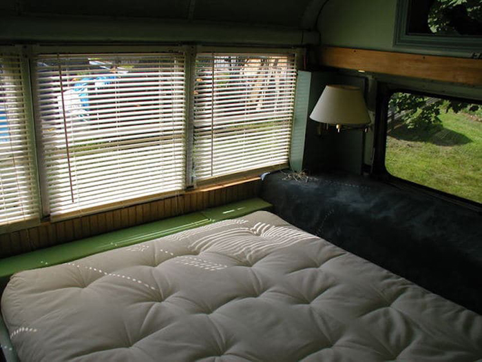 school bus conversion comfy bedroom
