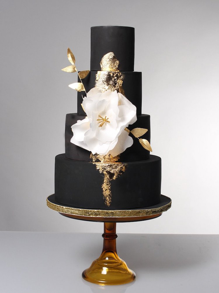 black wedding cake with large flower ornate