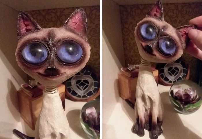 cat figurine big creepy eyes