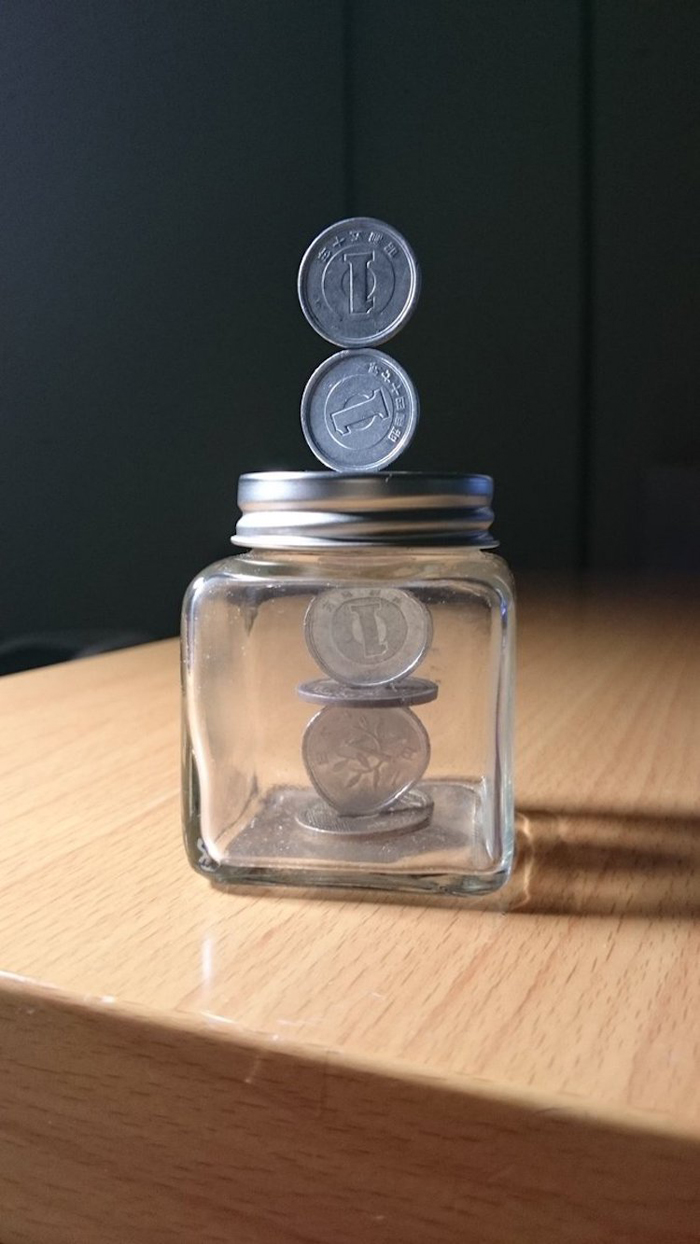 coin stacking sculptures glass jar