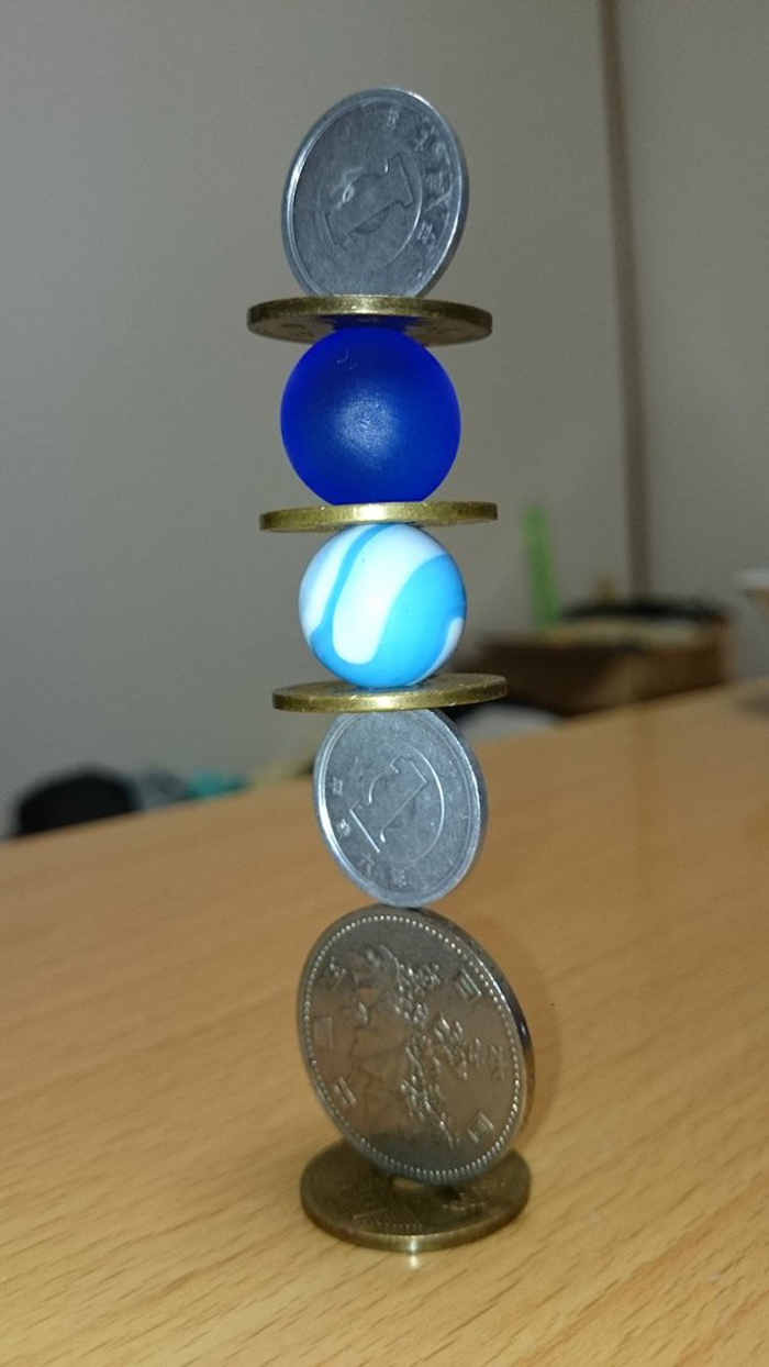 coin stacking sculptures marbles