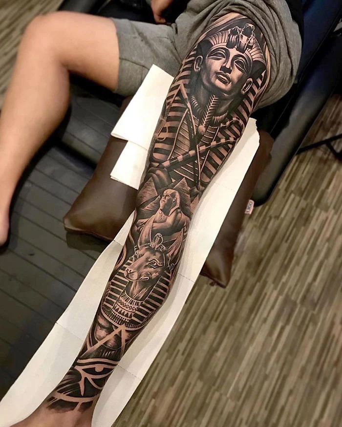 egyptian-themed epic leg tattoos