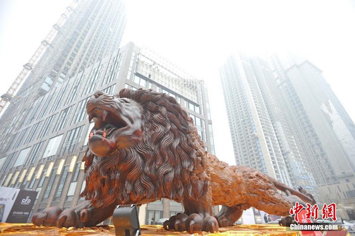 giant lion sculpture fortune plaza times square