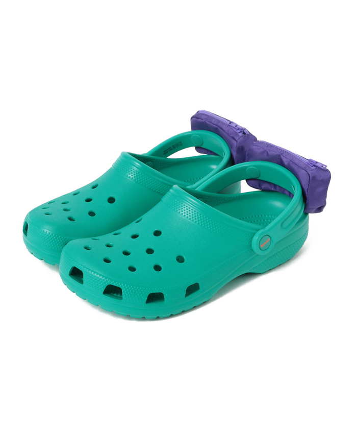green crocs with fanny packs