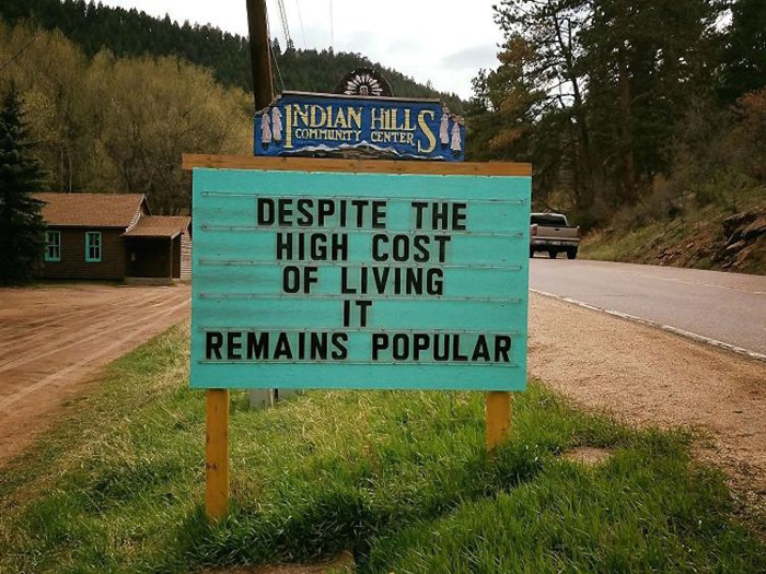 high cost living funny road signs