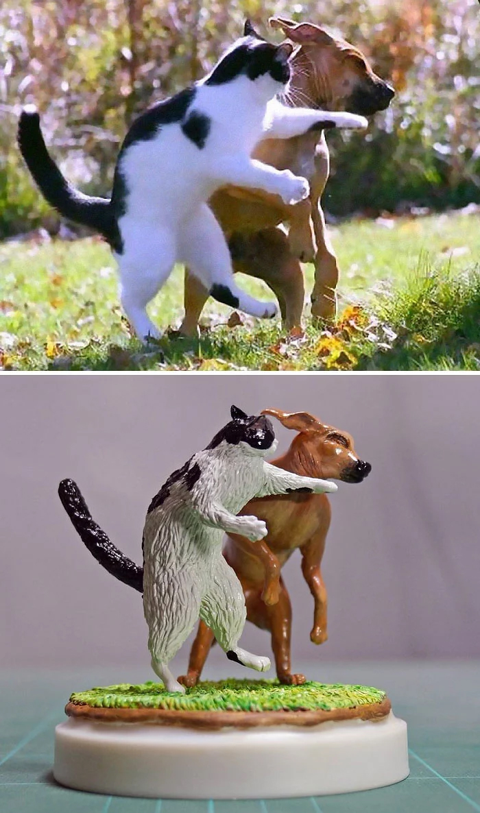 hilarious animal meme sculptures cat dog fight