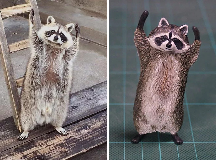 hilarious animal meme sculptures racoon hands raised