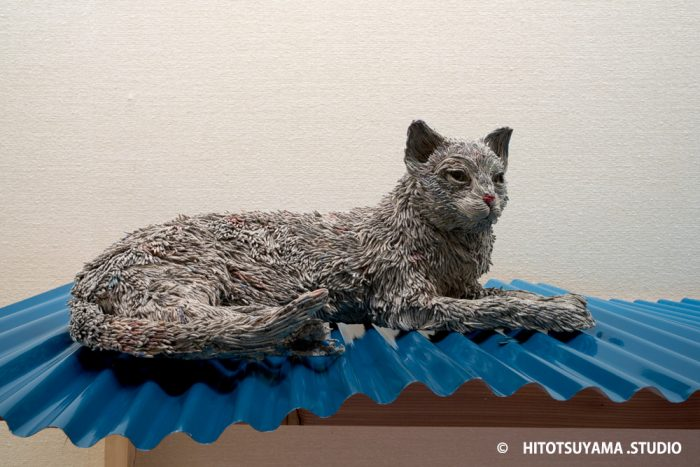 hitotsuyama newspaper animal sculptures cat
