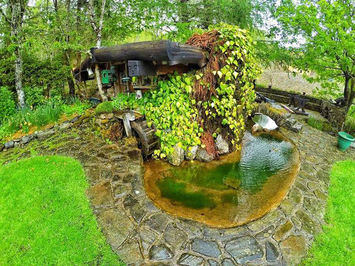 real-life hobbit house nearby pond