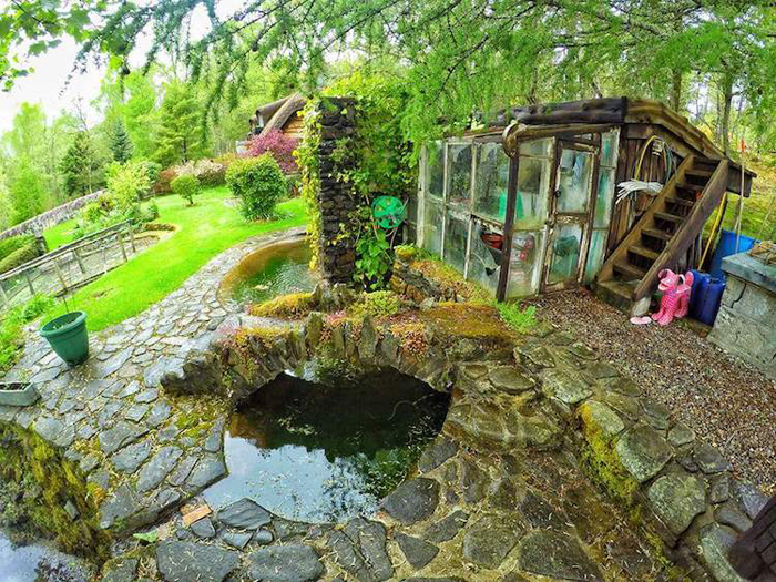 real-life hobbit house small pond