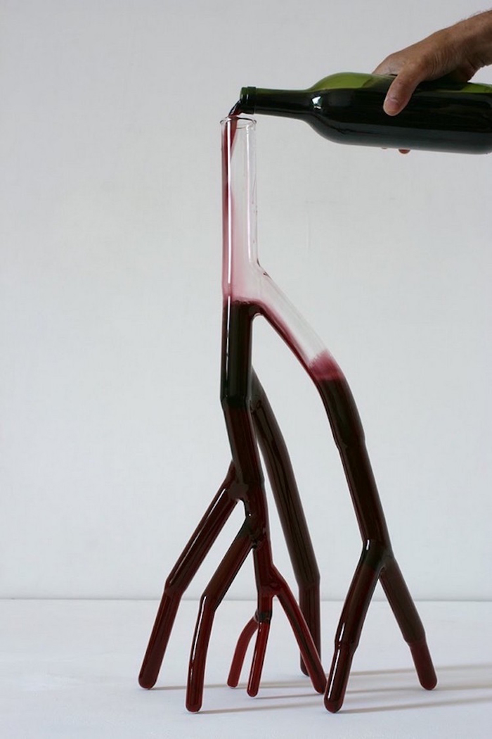 red wine poured in vein-like decanter