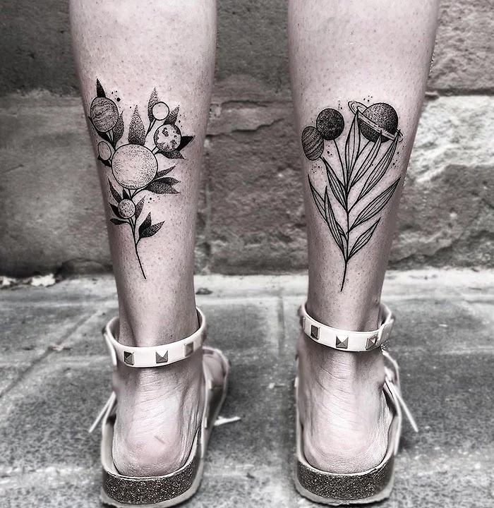 leg tattoos planet flowers