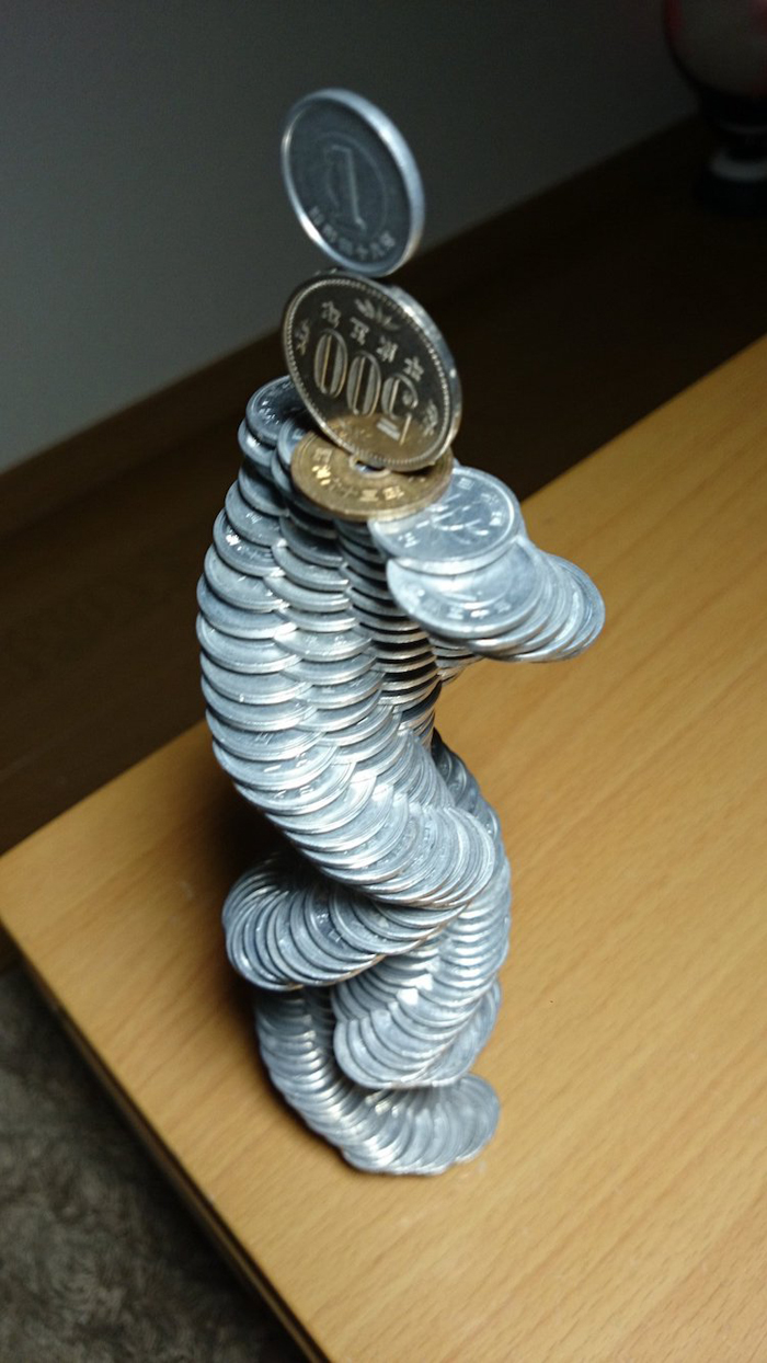 tanu intricate coin stacking sculptures
