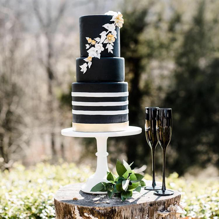 three-layered black wedding cake
