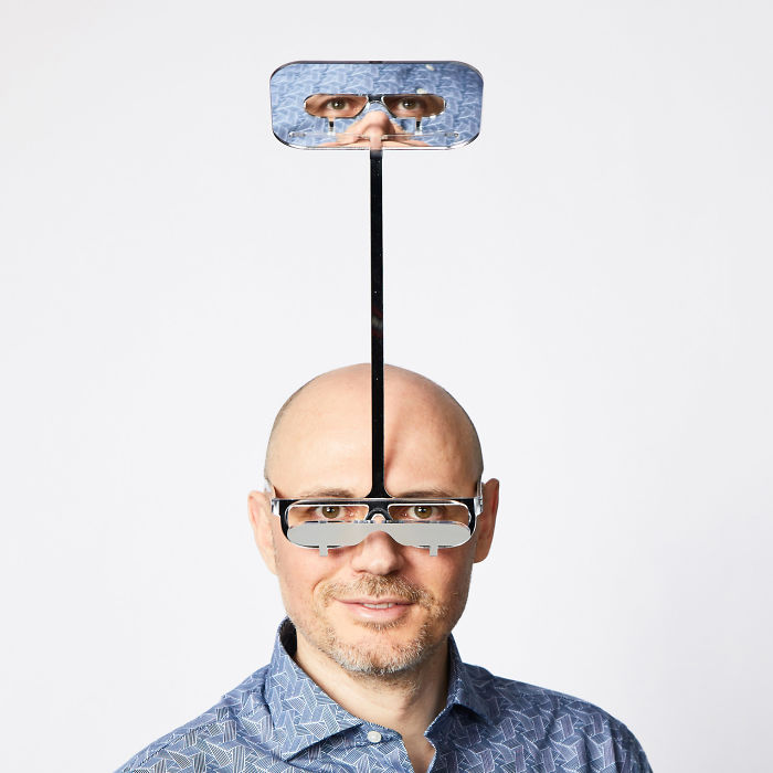 Dominic Wilcox wearing One Foot Taller Periscope Glasses