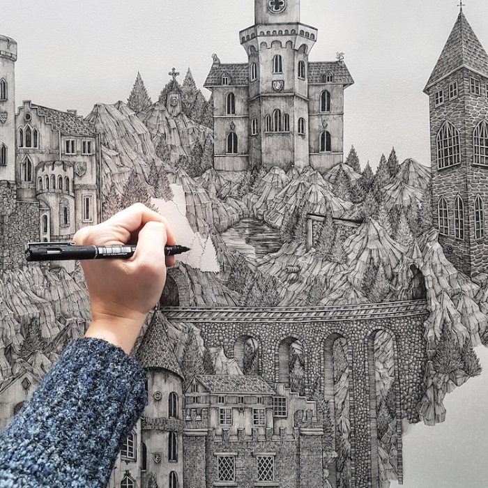 Olivia Kemp's hand doing a detailed pen drawing