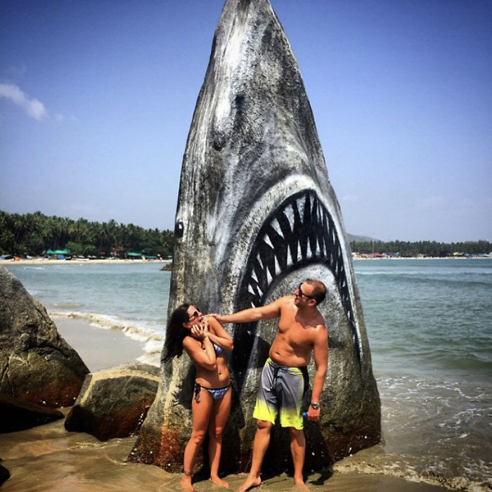 couple in front of great white shark jaws rock spray paint graffiti jimmy swift