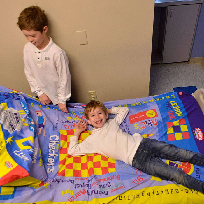 kids enjoying board game bed sheets