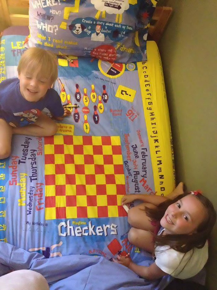 kids playing board game bed sheets